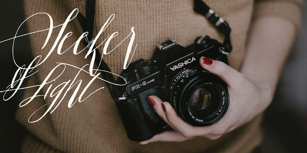white calligraphy lettering font overlaid on top of photograph camera seeker of light